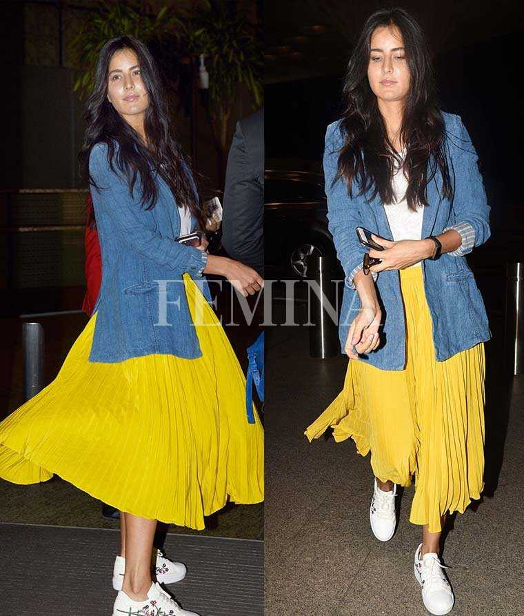 Katrina Kaif cheery plisséskirt with a blue jacket and white sneakers.