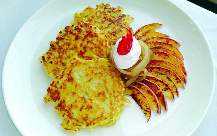 Potato pancakes with caramelised onions and apples