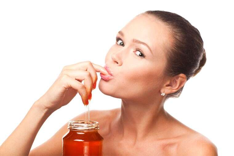 woman eating honey
