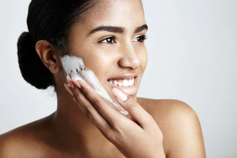 woman with cleanser
