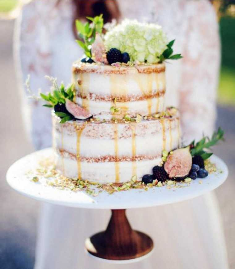 Fig naked wedding cake drizzled with honey and topped with hydrangea by @rufflledblog on Instagram.