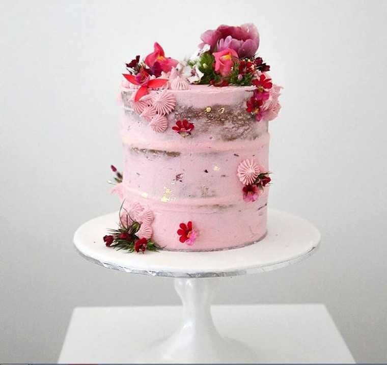 Semi-naked pink wedding cake at www.moncheribridals.com