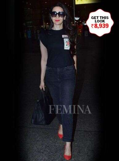 Karisma's all-black outfit with a smart dash of red